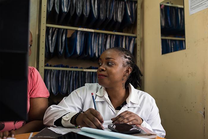 Dotty Nyambok provides HIV testing and treatment at the Embakasi Health Centre in Nairobi, Kenya.